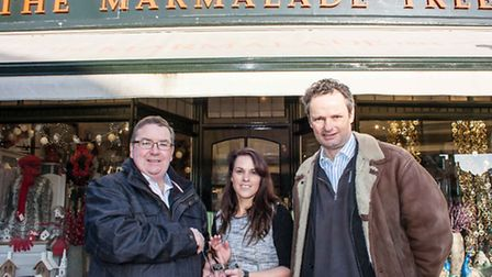 Lisa Stitchew of The Marmalade Tree, being presented with her trophy by Kevin Vail, chairman of Wave