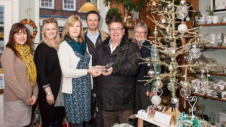 Jackie Bell, owner of Bells of Suffolk, and her team being presented with a trophy for runner up by