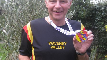 David Mower with his race medal.