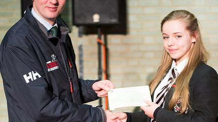 Isabel Cuffe presenting the cheque for Walking for the Wounded to Fergus Williams.