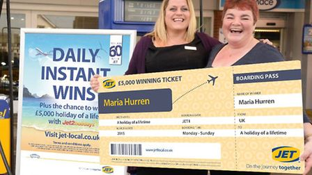 Louise Hammond, manager of JETs AW&D Hammonds forecourt, with competition winner Maria Hurren.