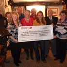 Shadingfield villagers present the cheque to representatives of the Beccles Branch of the Royal Brit