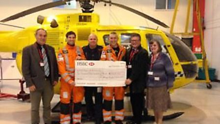Members of Halesworth Antiques Market present the cheque to the EAAA.