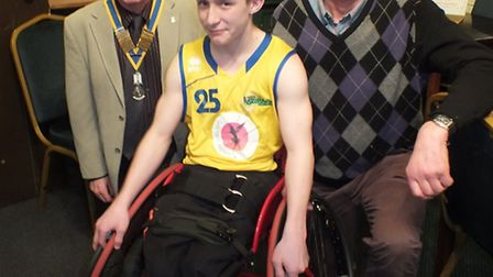 Ryan Revell in his wheelchair provided by Bungay Rotary Club, with president Tony Sprake and rotaria