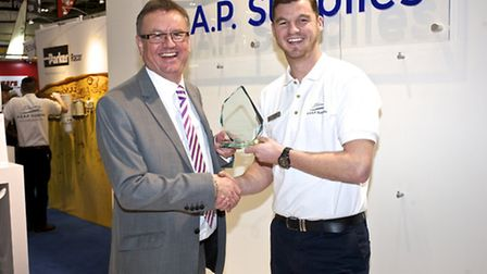 Shaun Wigley, of ASAP Supplies, is presented with the 2014 sales growth award from Adrian Foster of