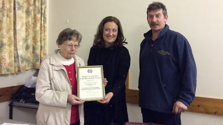 Three Rivers Talking Newspaper co-founder Joan Wuyts (left) presented with her long service award by