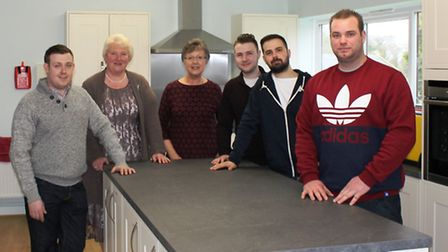 Contractors and project leaders gather to celebrate the completed villlage hall kitchen at St James