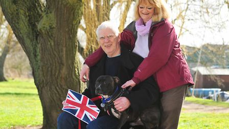 Gilbert the dog with his owners Janet and Ian Bevis. Gilbert has been entered into a competition fo