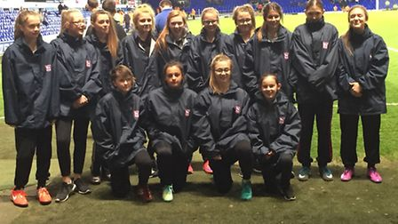 Members of the Waveney Foxes Under-14 girls football team who were ball girls at Ipswich Town's game