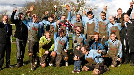 Bungay Town Reserves plyers and officials celebrate their Suffolk FA Sunday Trophy win.