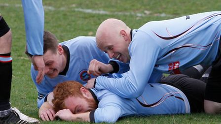Matthew James (on ground) is mobbed by his team-mates after scoring one of his two goals.