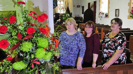 Worlingham Church Flower Festival.Isobel Mison, Karen Warner and Shirley Davey looking at one of the