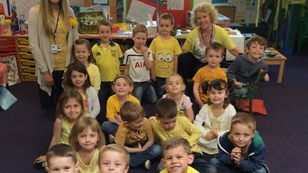 Classmates of Megan Saul wear yellow to raise money for cystic fibrosis charity