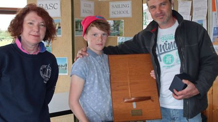 Commodore Shirley Roll with Norfolk Open winners Glen and George Curtis. Photo: KAREN LANGSTON