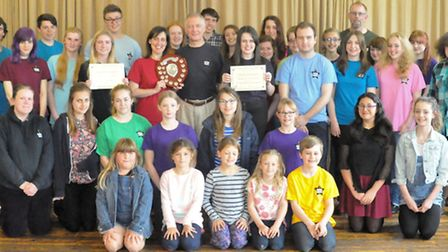 The Rising Stars cast and crew with the award shield and certificates.