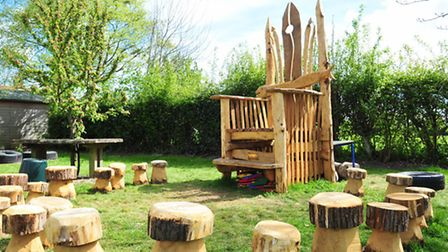 Wenhaston primary school children enjoying the giant story chair that has been made by local craftsm