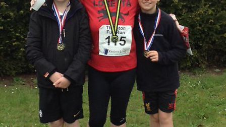 Loretta Thurston with sons Corey (left) and Kai sport the medals they won at Thurston''s combined ru