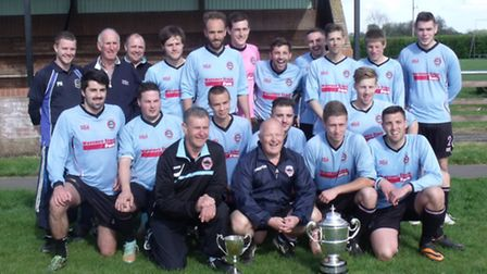Bungays squad with the Anglian Combination Division Two trophy and the Junior Knockout Cup.