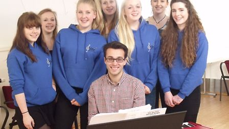 Members of Bungay youth choir Cantaria, with Jason Collins.