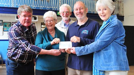 Members of the Beccles Festival present a cheque for over £3000 to the Beccles Public Hall to instal