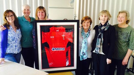 Open Door volunteers, carers and therapists with the signed rugby shirt.