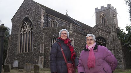 Friends chairman Ann Wilkinson with vice chairman Doreen Hale outside St Mary's Church in Halesworth