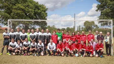 Woodton FC team (in organge and black) with old players and Halesworth Town FC. Picture: Nicholas Je