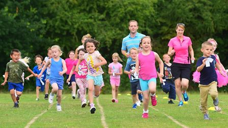 Year 1 children at Beccles Primary Academy take part in a Race For Life event around the school fiel