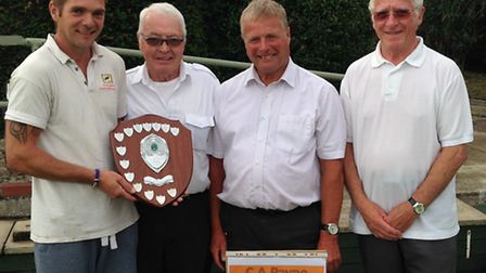 Chris Payne, left, of C A Payne presents the winners shield to, left to right, Don Brearley, Alan Bu