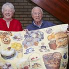 Margaret Bacon (left) presents her quilt to a Grenville Court Care Home resident