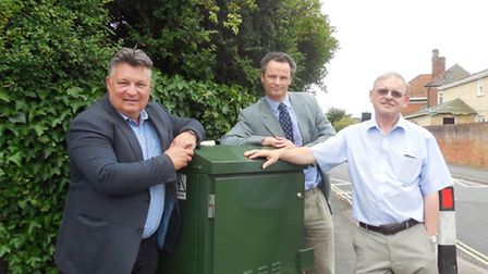 Suffolk County Councillor Mark Bee, Waveney MP Peter Aldous and Tony Twomey. at the BT box which sho