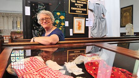 Smocking exhibition at St Mary's church, Bungay. Jacqueline Holmes demonstrating the art.