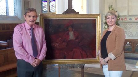 Dr Bill Teatheredge with an original Munnings' painting of gypsy woman Nelly Gray, which was on show