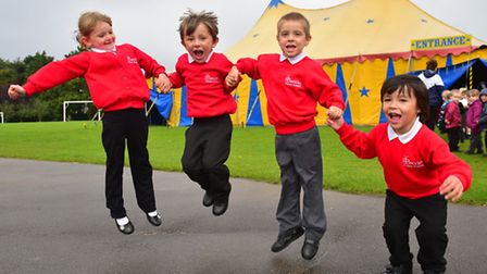 Reception class try out circus skills inside the Ferrel circus tent.