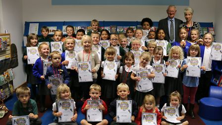 Children collecting their reading challenge certificates from Halesworth Library
