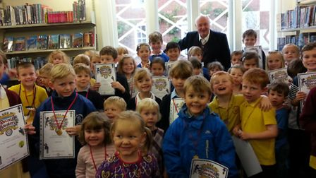 Children at Bungay Library picking up their certificates for successfully completing the summer read