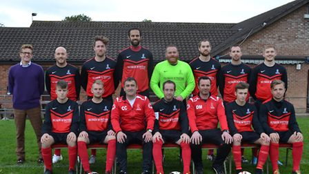 Loddon United line up with their sponsor.