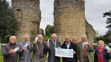 Bungay town reeve Terry Reeve and John Groom (centre with the cheque for the total amount handed out