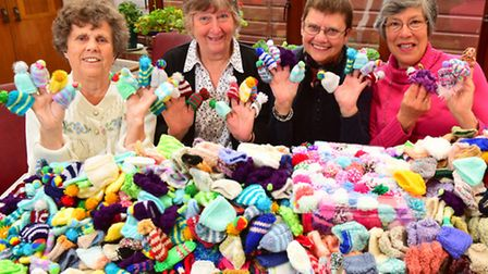 Members of the Waveney Centre have knitted tiny hats to raise funds for Age UK.Left to right.. Wendy