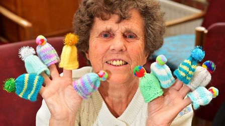 Members of the Waveney Centre have knitted tiny hats to raise funds for Age UK.Wendy Somersby who kn