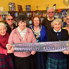 Volunteers from The Sign of the Fish book shop in Halesworth celebrate the book shops 25th anniversa