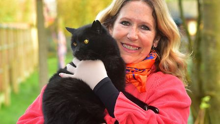 Sara Higgins from Blossoms Rescue Centre with Sooty the 26-year-old cat.