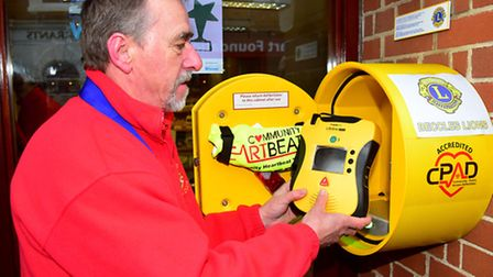 Beccles Lions president Keith Moore with the new defribrillator.PHOTO: Nick Butcher