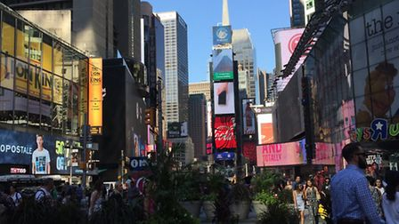 The view from outside Charlotte's window of Times Square.