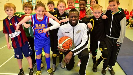 GB bastketball player Joseph Ikhinmwin working with youngters at Beccles Primary Academy.PHOTO: Nick