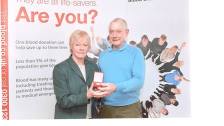 Janet Carter who has been awarded for donating 100 pints of blood, pictured with her husband Terry.