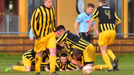 Celebration time for Beccles players after Scott Barnard's late winner against Bungay. PHOTO: Nick B