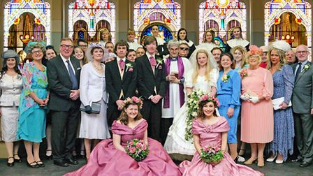The Waveney Light Opera Group cast assembled for a wedding in The Best Man.