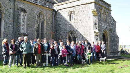 Members of the community celebrate a funding boost for St Mary's Church in Denton.