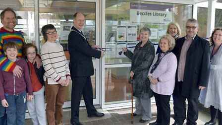 Trustees of Beccles Library mark the increase in the library's opening times.